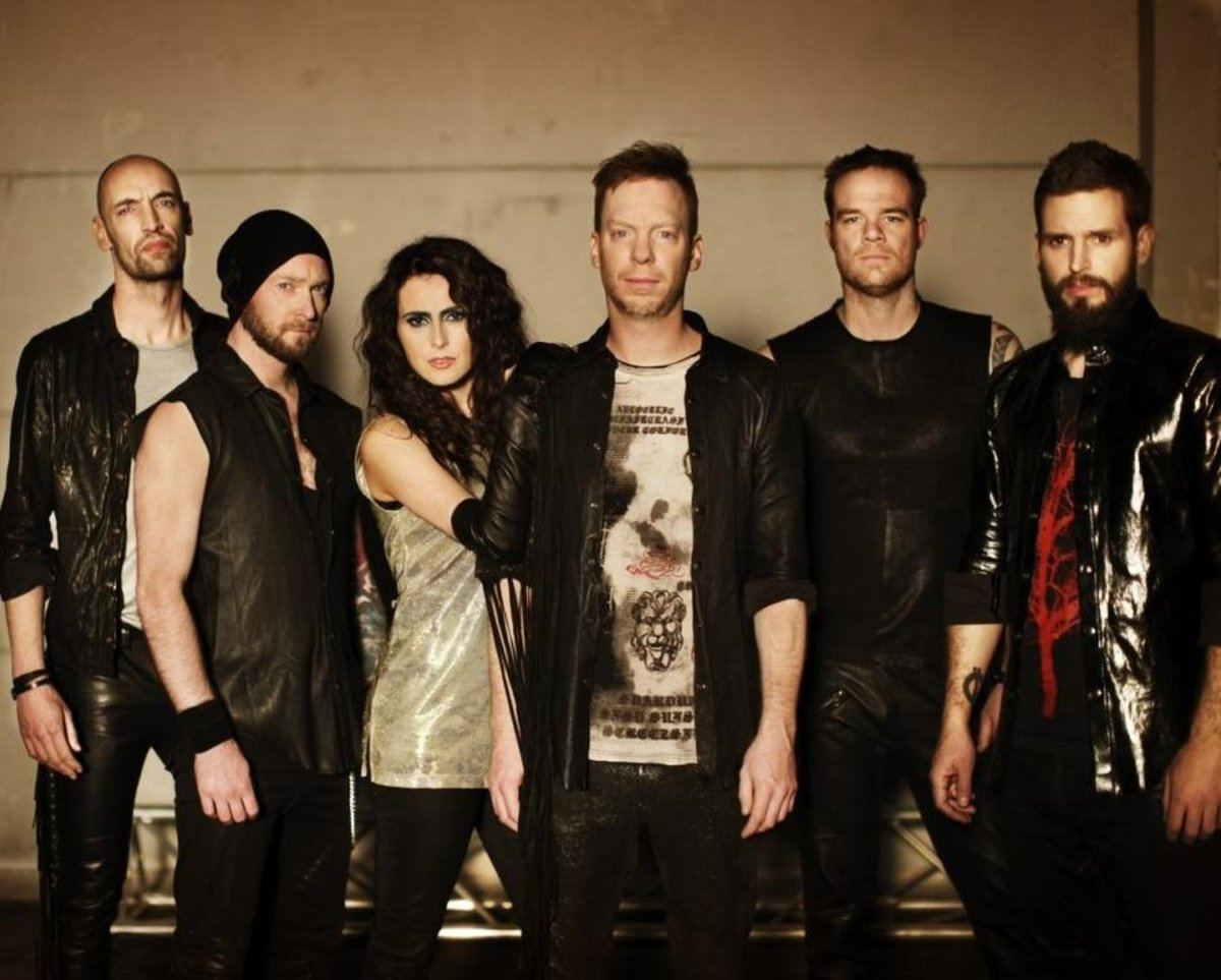 Robert Westerholt (guitars) is at the far left. His brother Martijn is next to him. And Sharon Den Adel is pictured third from the left.