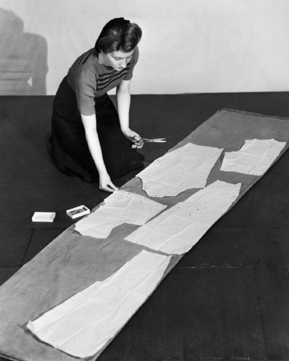 Woman cutting pattern 1942; UK Government; PD