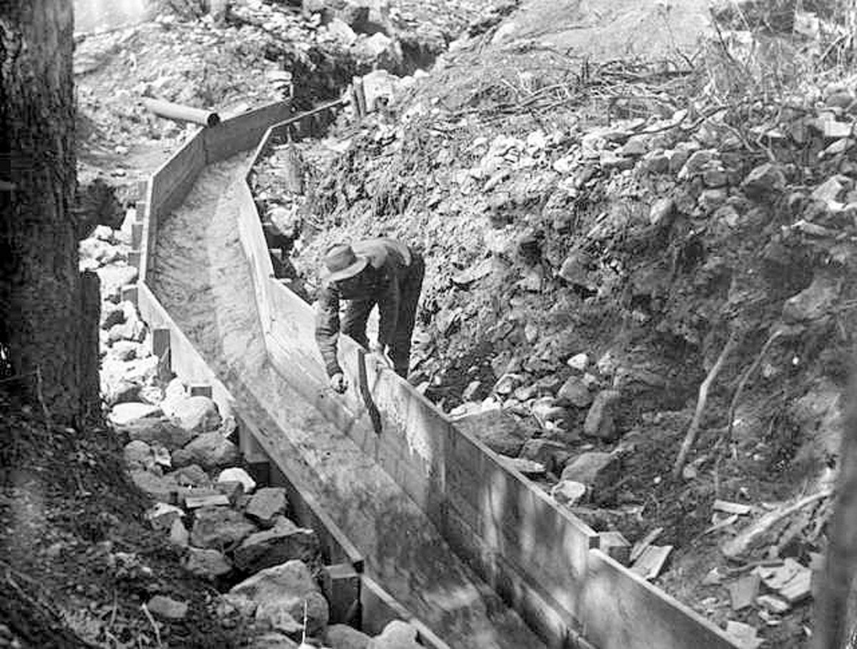 Public domain photo of sluice for separating dirt from gold in water