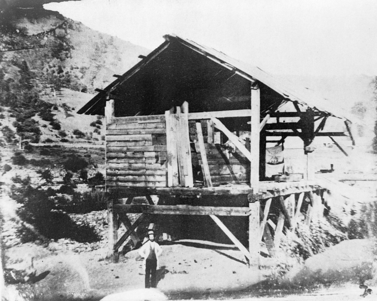 """Photomechanical reproduction of the 1850 daguerreotype shows James Marshall standing in front of Sutter's sawmill, Coloma, California, where he discovered gold."" Person depicted is most likely not actually Marshall."