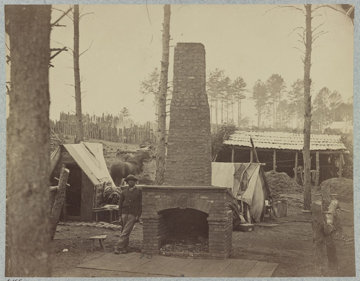 Notice the elaborate fireplace that the soldiers built. The camp is being cleared away and it is left standing alone. This was for a general. Brandy Station