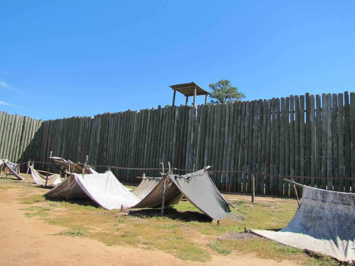 This reconstruction shows how prisoners of war created shelters for themselves in Andersonville Prison in Georgia. The lucky ones used canvas to form tents and a few even got some wood for slightly larger structures. The majority lacked any shelter.