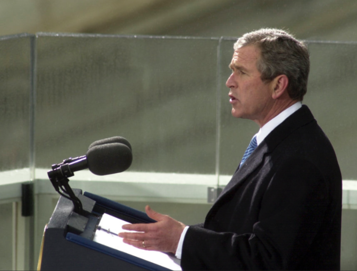 President Bush is seen here using a page weighted speech folder while giving a speech.