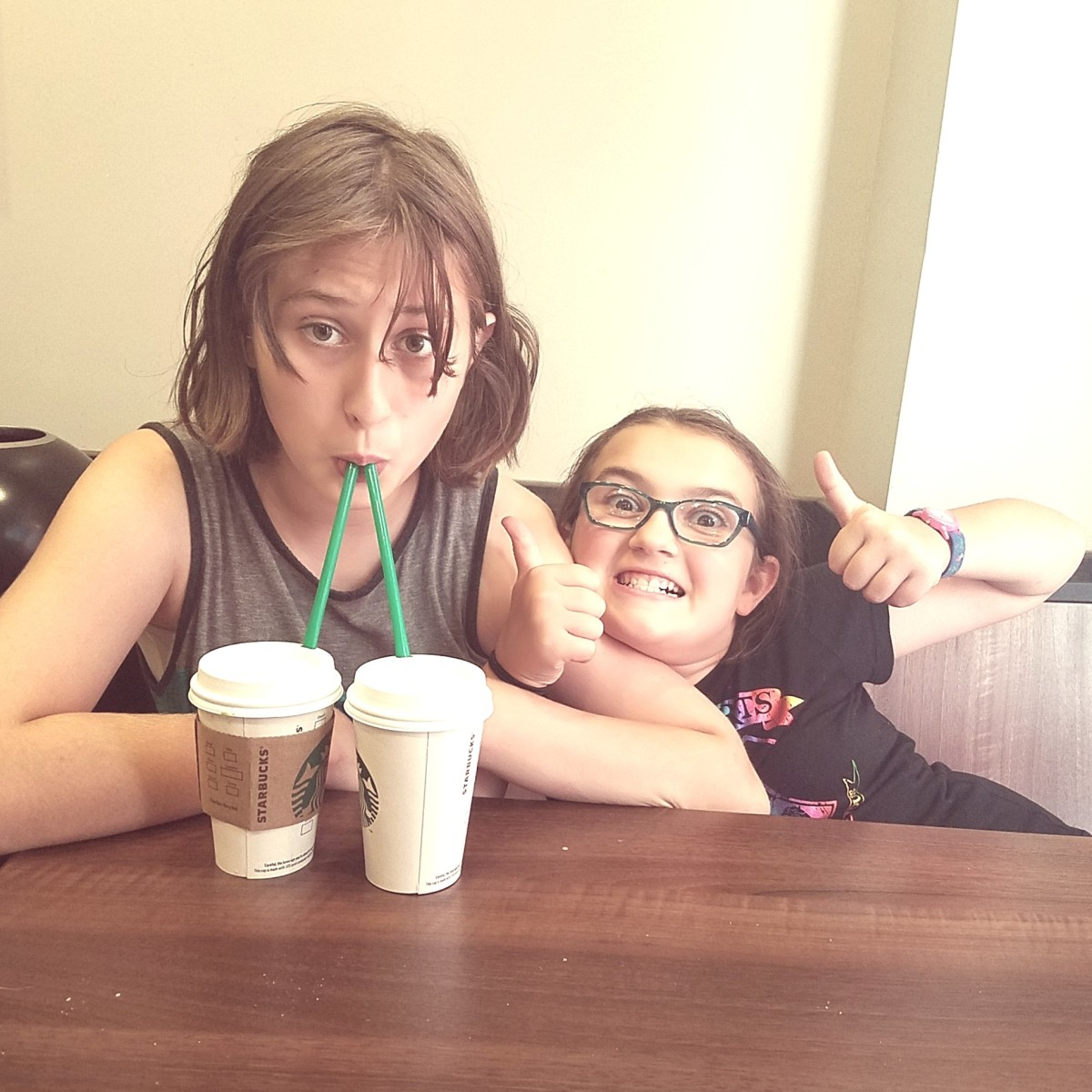 My daughter and a friend cavorting at Starbucks