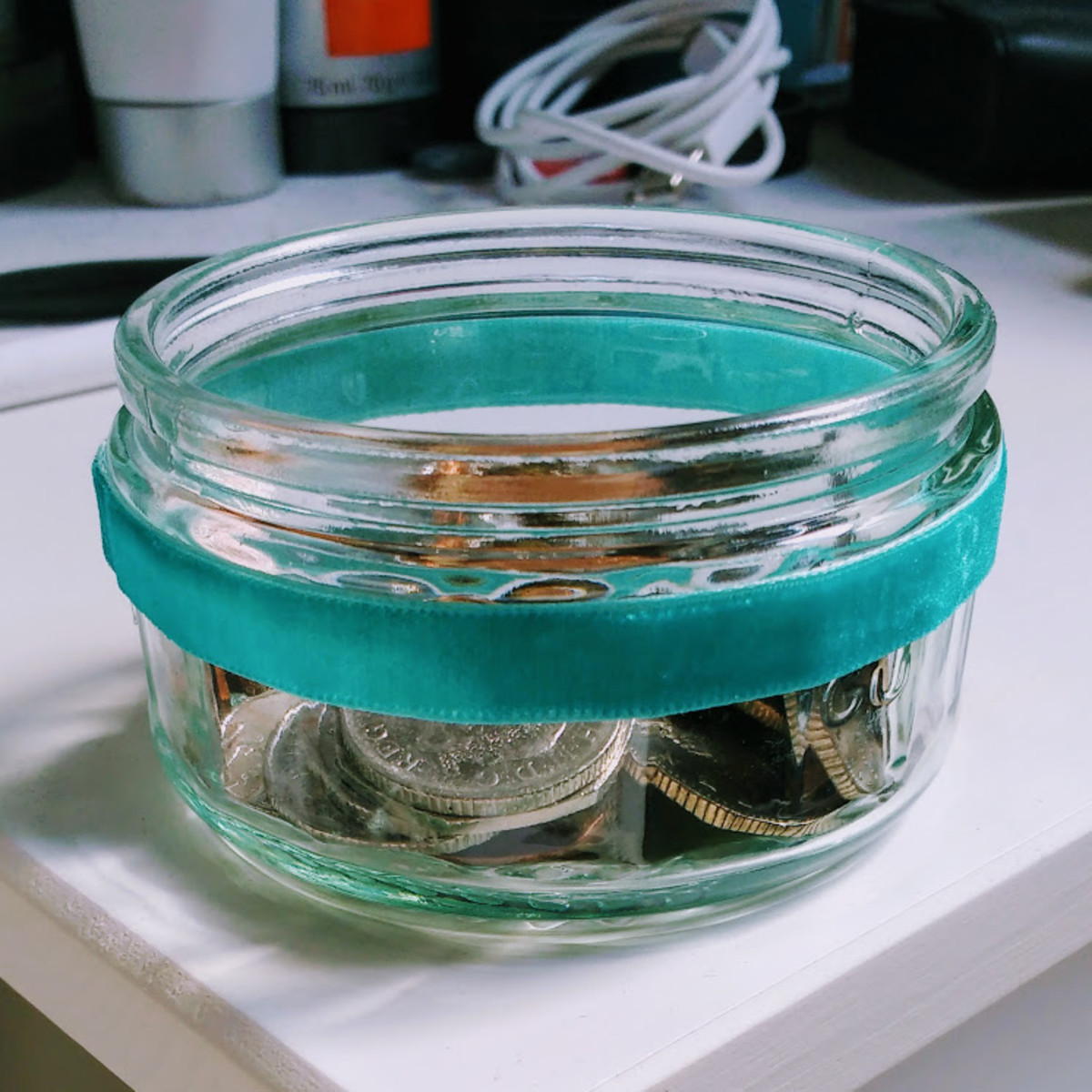 I decorated my spare change ramekin by gluing a piece of ribbon around it.