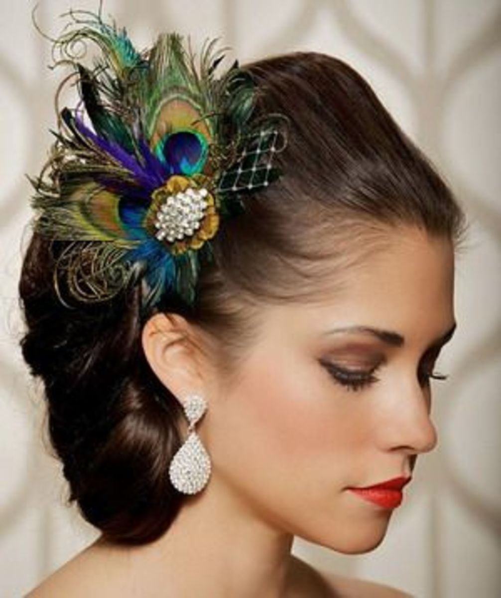 This beautiful hair piece carries the peacock theme with elegance and grace