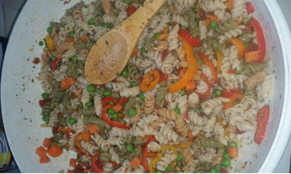 Suddenly Salad Classic with diced tomatoes and sliced sweet peppers, frozen peas and cubed carrots added.
