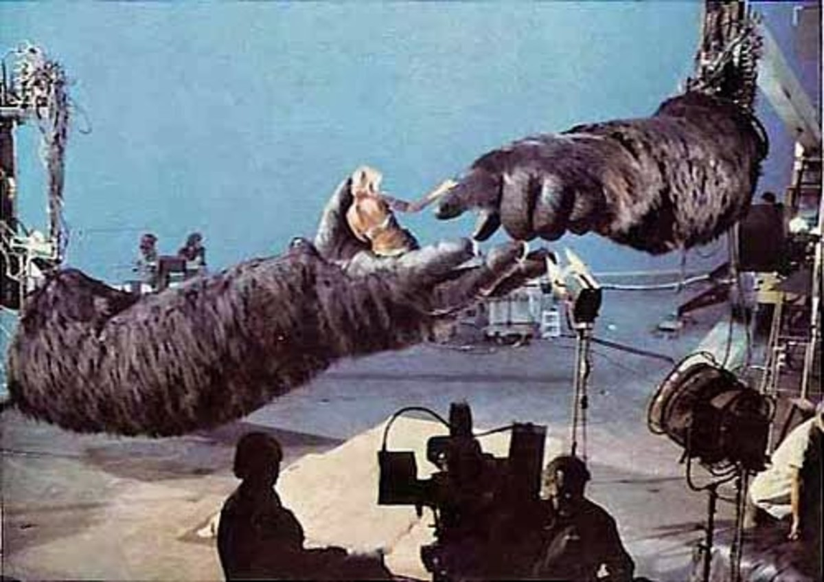 Behind the scenes of King Kong (1976) showing Jessica Lange in the hands of the robotic gorilla being controlled by computers. It's noticeable in the movie when the camera switches back and forth between the robotic King Kong and the real actor.