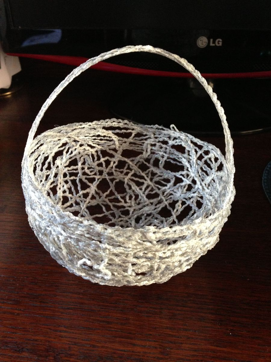 Yarn basket made with left over yarn and glue