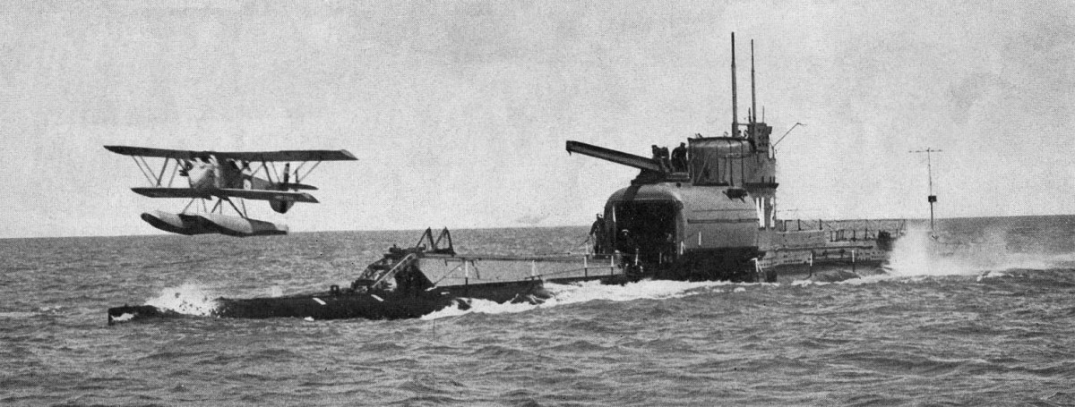 A British submarine carrier launching a float plane.