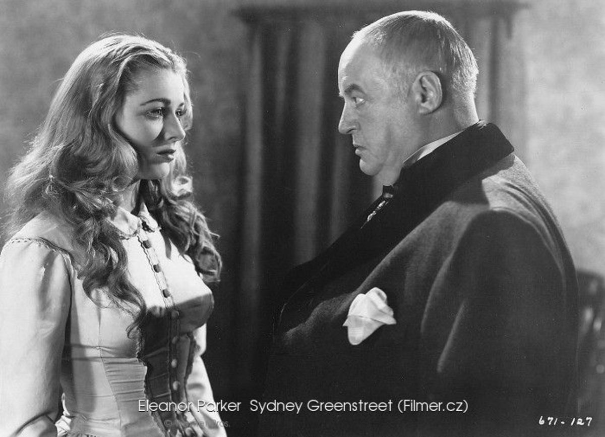 Sydney Greenstreet as Count Fosco hypnotizing Eleanor Parker as Laura