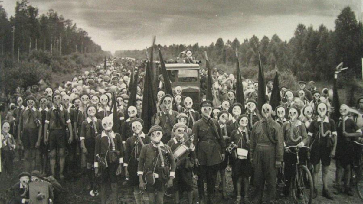 A photo of the island residents all wearing gas masks!!