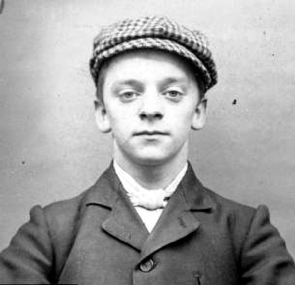 A police mugshot of Harry Fowles, a baby faced member of the real Peaky Blinders.