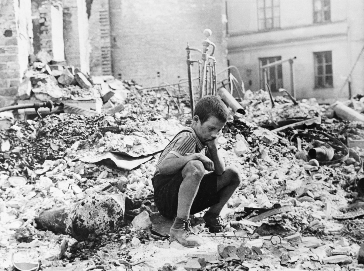 Young Polish survivor of Nazi bombing of Warsaw, photographed by Julien Bryan.