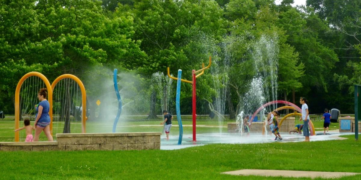 Having fun in the splash pad in Cullen Park