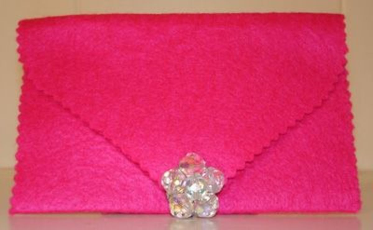 this was cut with pinking shears & decorated with a vintage clip earring