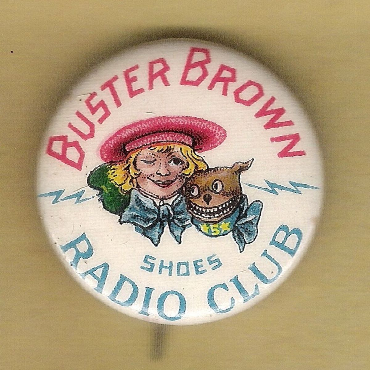 One of the iconic Buster Brown Shoes Radio Club pins.