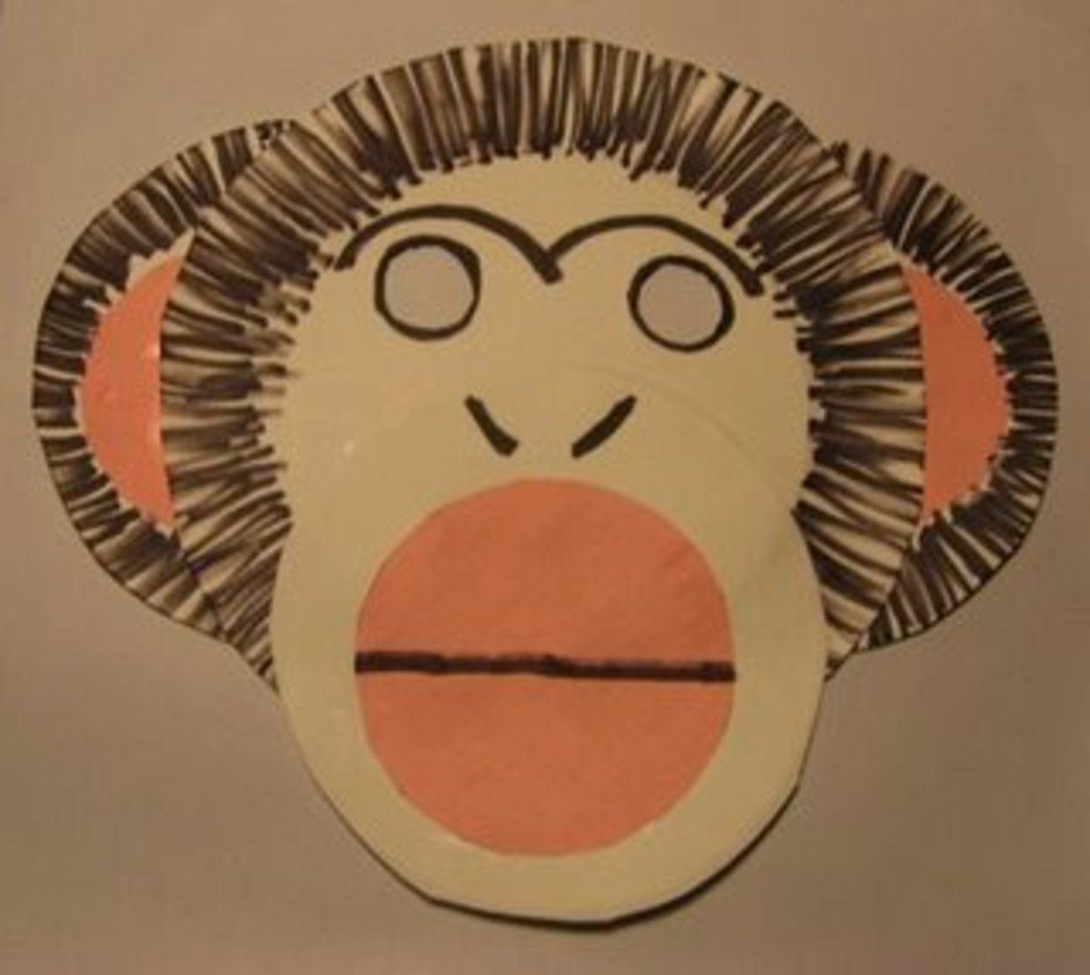 Overlapping paper plates can make more complex shapes like this monkey.