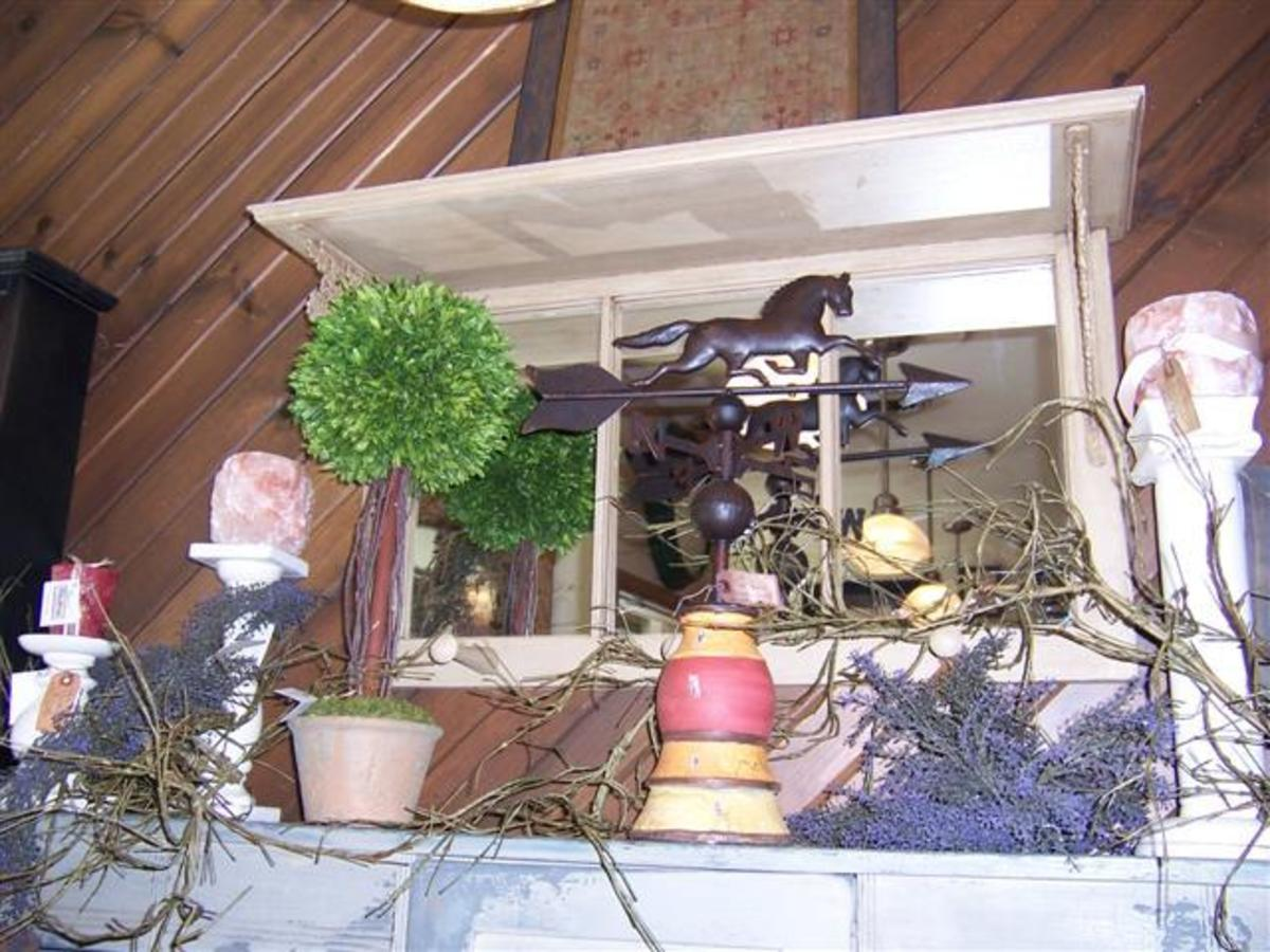 .old shelf with a window in back and mirrors added.