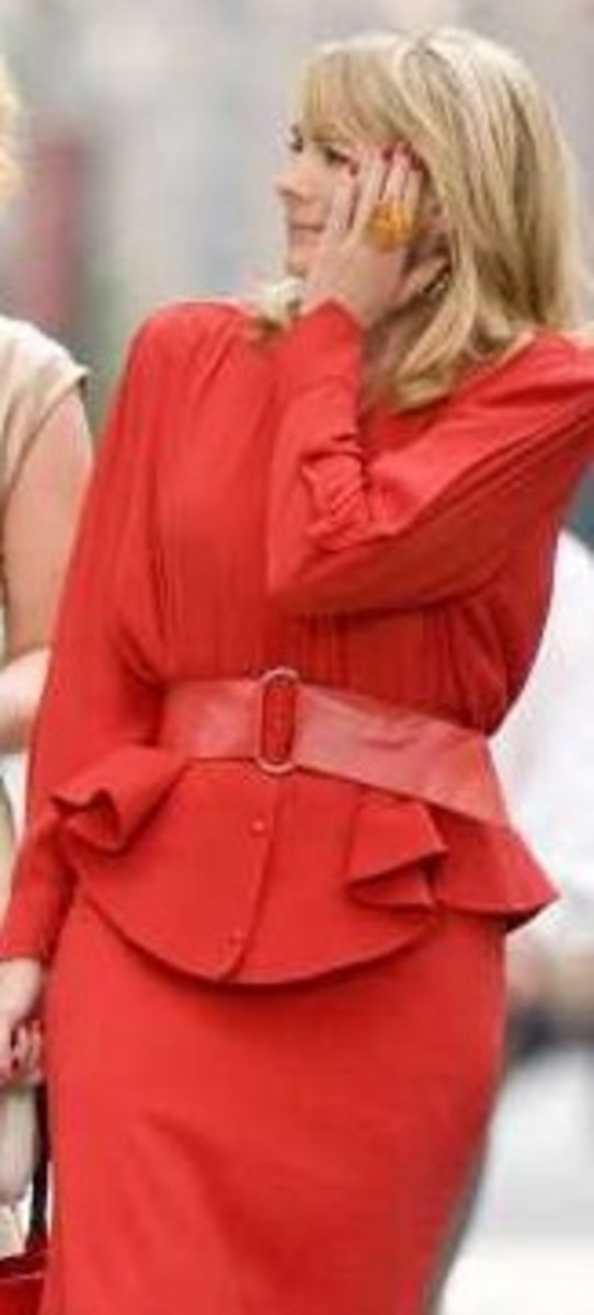 Kim Cattrall dons 80s shoulder pads, wide belt, peplum and bright 80s inspired color