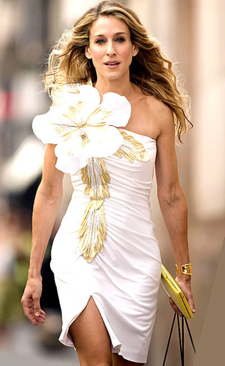 Sara Jessica Parker manages to keep a straight face, even with this gigantic flower. The dress, vintage, was a find by Patricia Fields, costumer to Sex and the City.