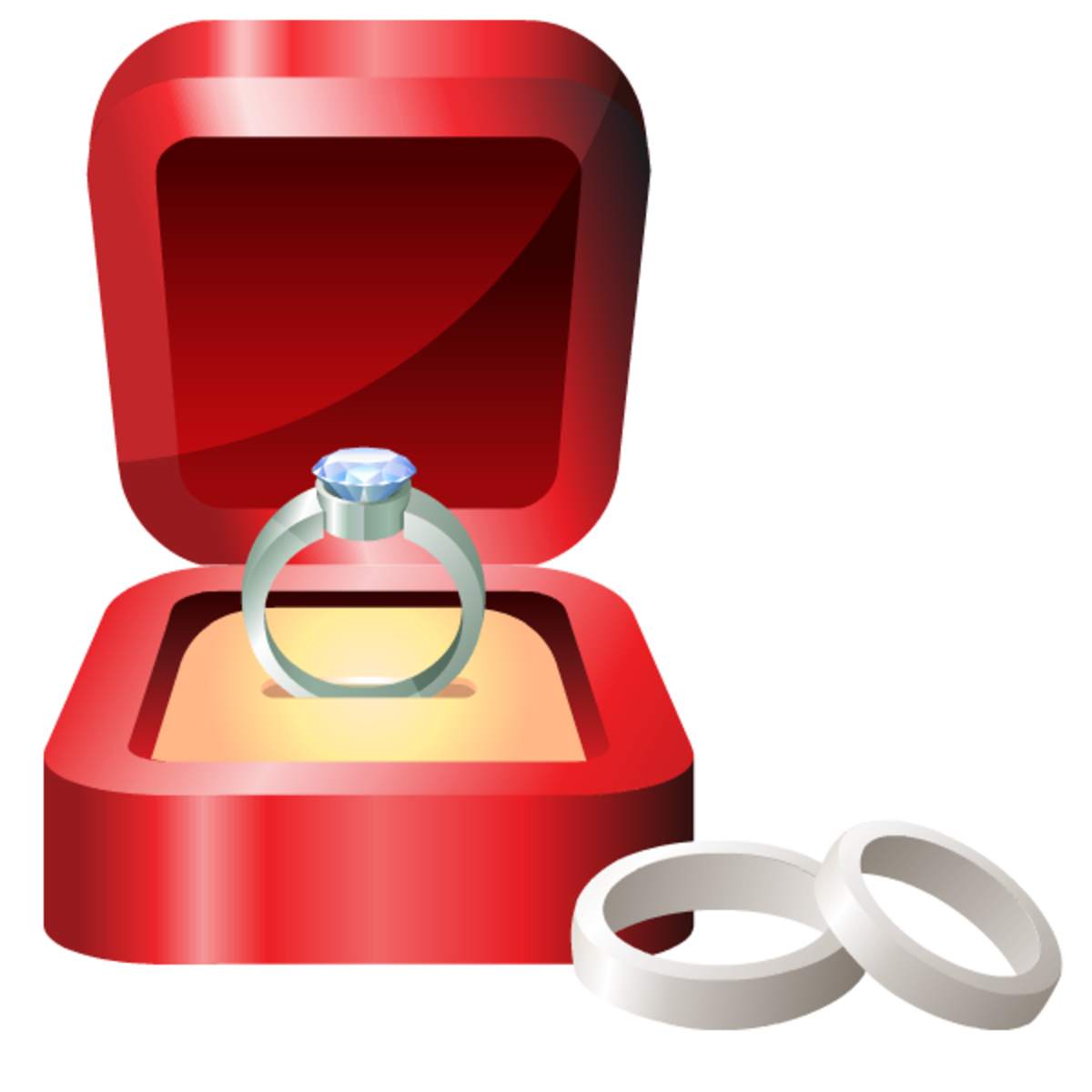 Platinum engagement ring in red velvet box with platinum wedding rings