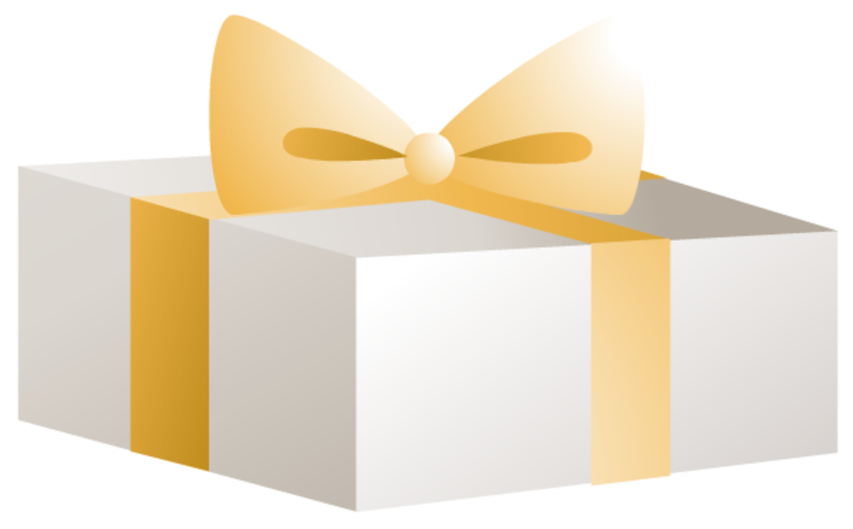 White present with gold ribbon and bow