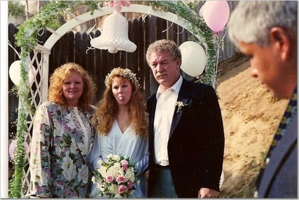 My mom, me and my stepdad at my wedding