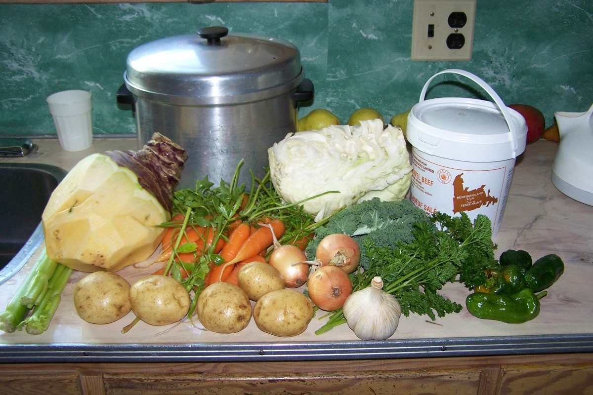 The boiling pot, the vegetables to make ready, pail of salt beef.Celery, Turnip, carrots, cabbage, onions, garlic, peppers, 2 small kale leaves, parsley, sprig of rosemary, Maggie (Loveage)and potatoes.