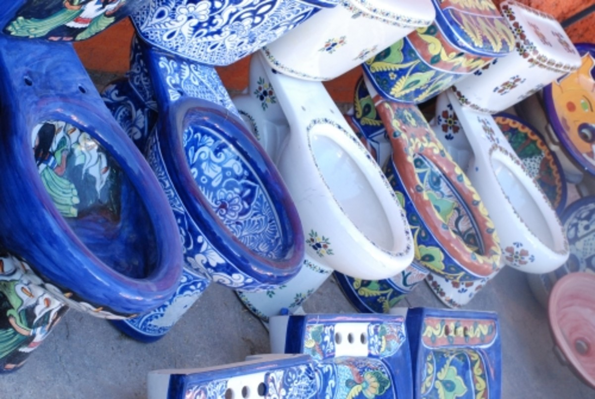 No!  Practical, beautiful, crafted by local artisans in a style consistent with and representative of the culture, these hand painted Mexican toilets are folk art!