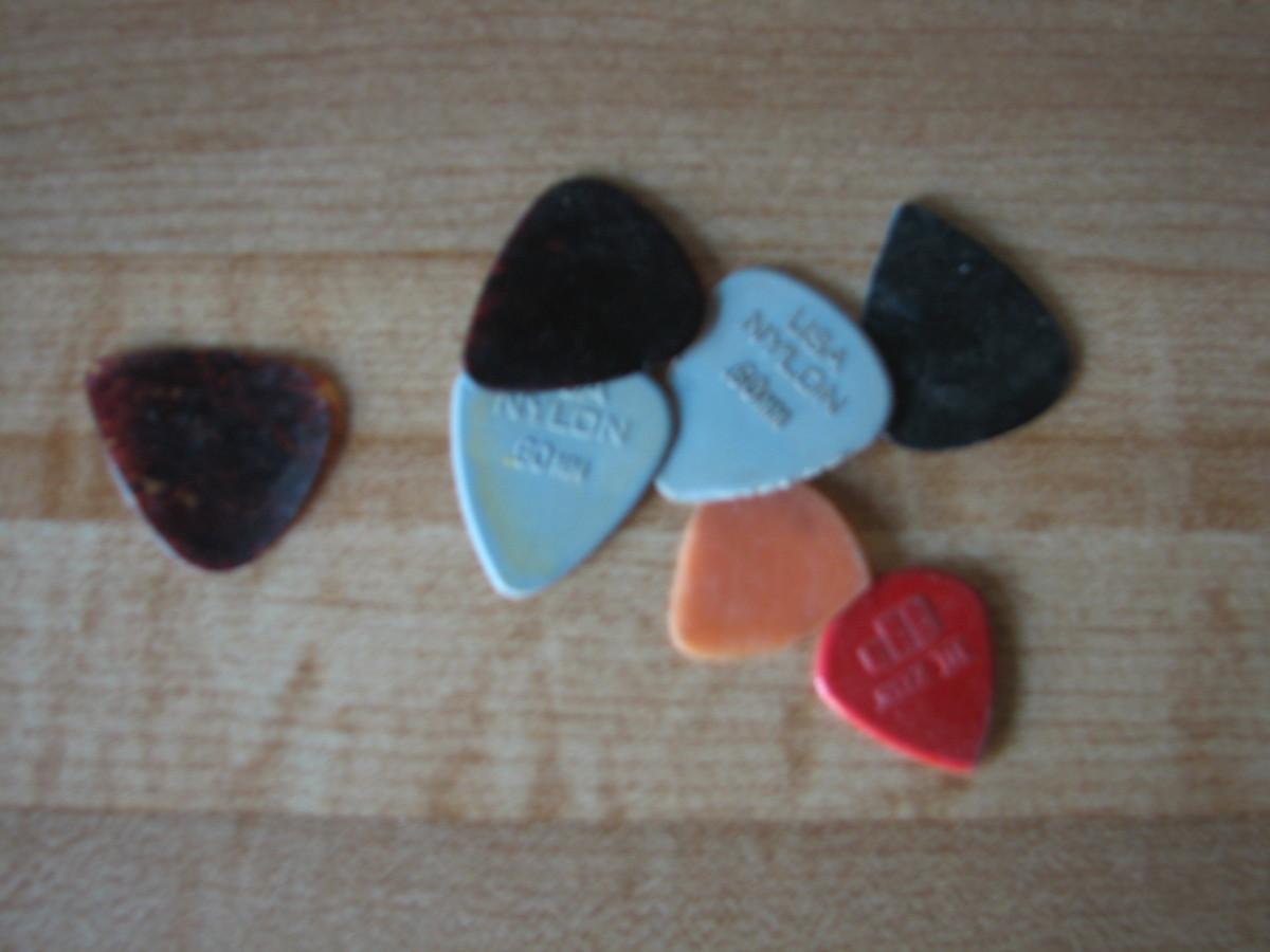 This group of picks were in one of the jars that lives on my computer desk. No reason to save them but maybe they are holding old songs they have plucked!