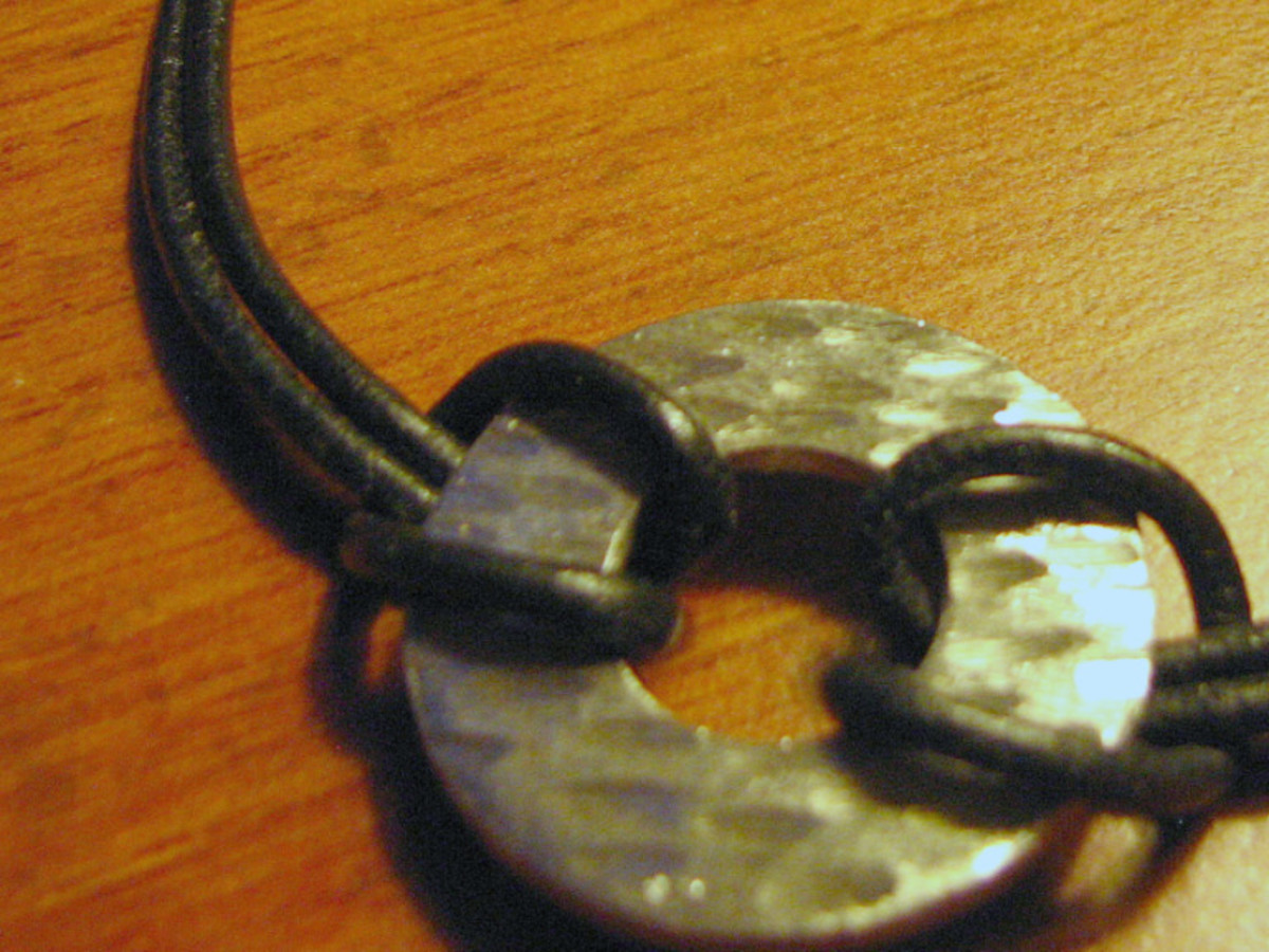 Collecting odd things can help if you have a creative spirit. This bracelet I designed was a very rusty washer before I went to work on it.