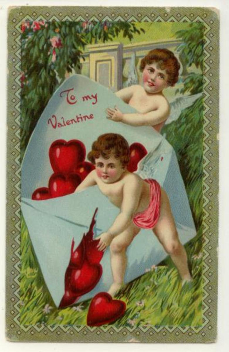 Cherubs with an envelope full of Valentine's Day hearts vintage Valentine card
