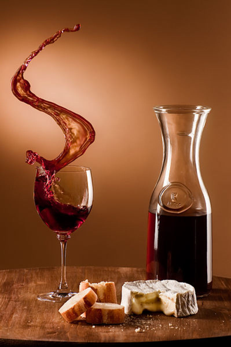 All objects were fastened on the board, which was pushed from the side, causing the wine to spill out of the glass. Produced using a limit switch. The carafe is filled with gelatine made with wine.