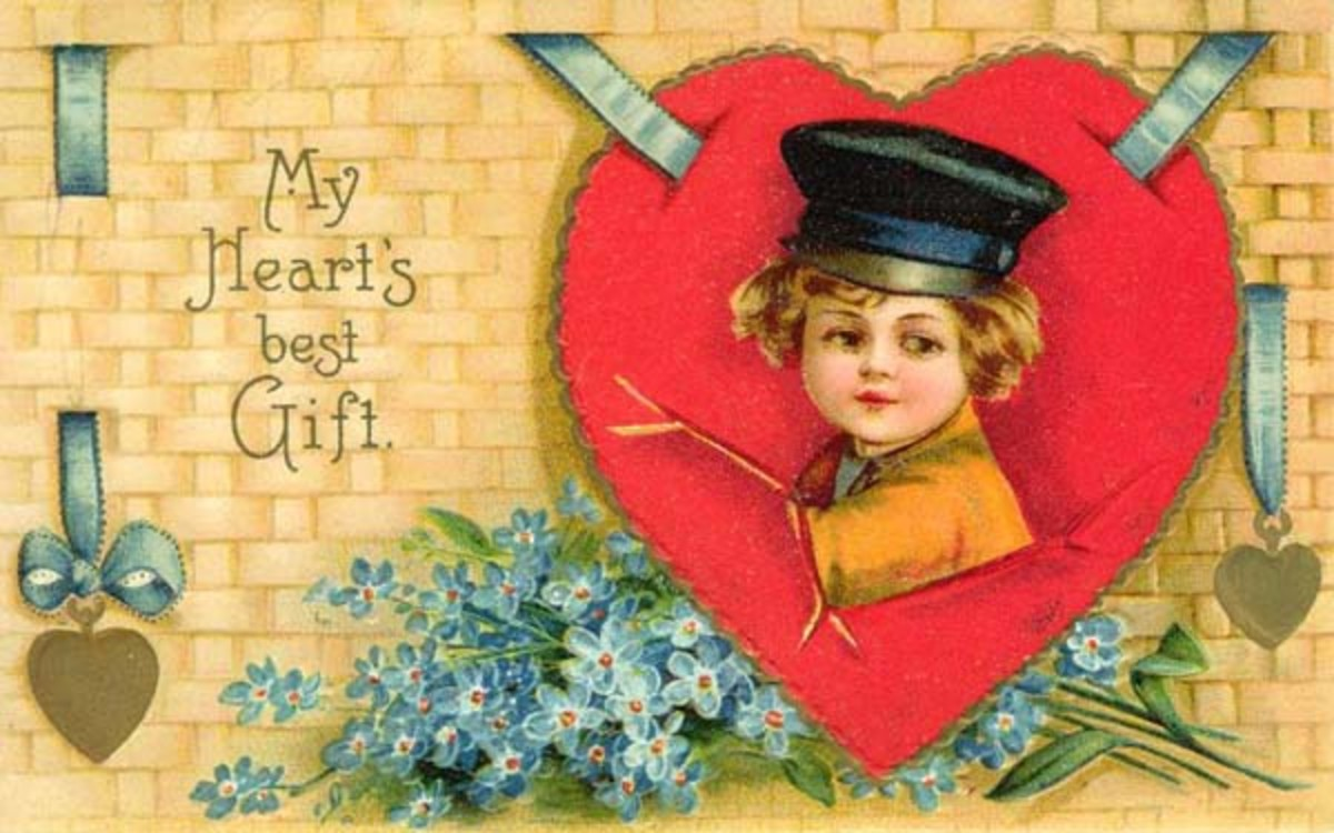 Cute kids: little boy in red heart with blue flowers