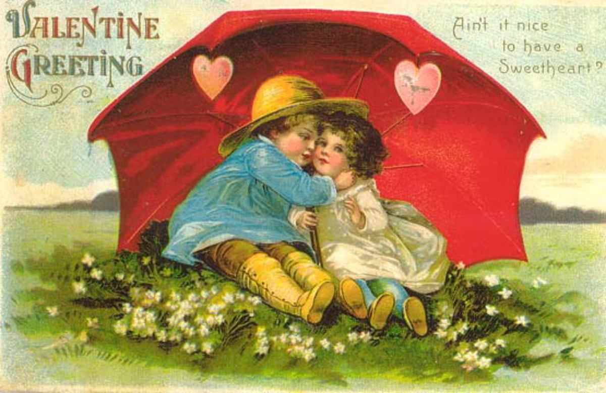 Cute kids: little boy and girl under red umbrella with pink hearts