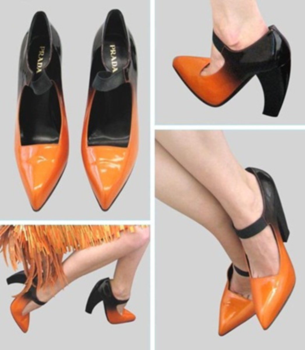 The super-gloss orange colour sharply fades to black.  With black elasticized ankle strap these Prada designer shoes are offset by a pointed closed-toe and curved  heel.