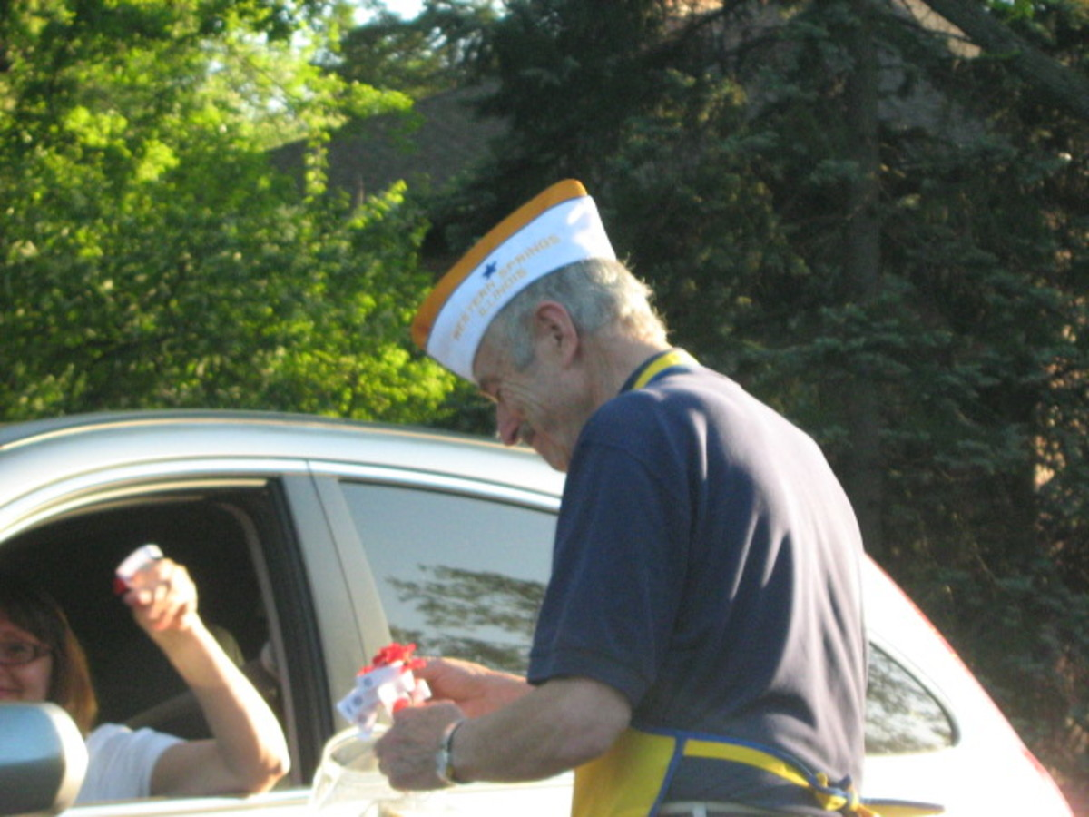 Veteran at a busy intersection collecting for Veterans just before Memorial Day 2009
