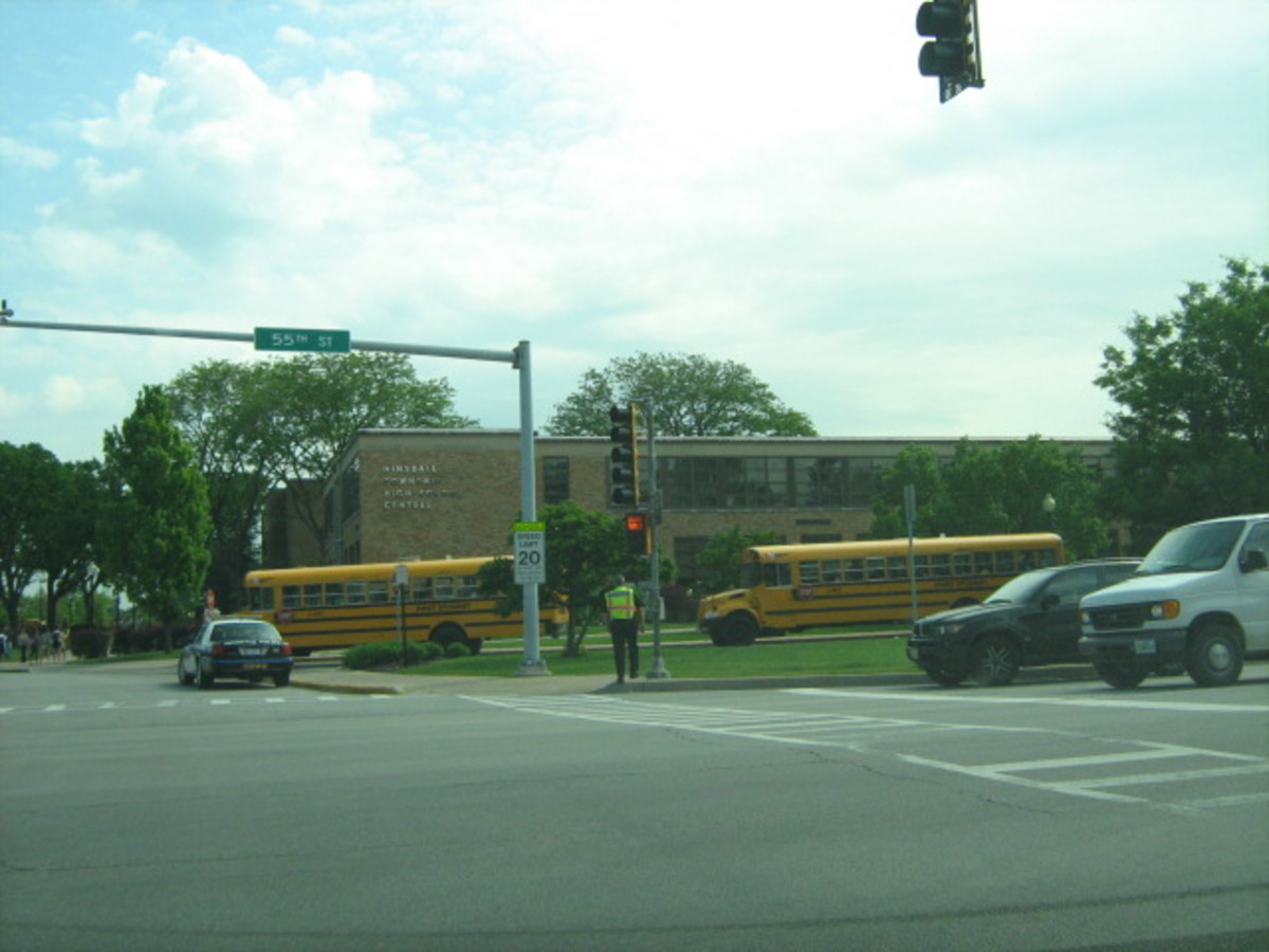 School buses and Hinsdale Police near crosswalk at 55th Street when Hinsdale Central High School dismisses