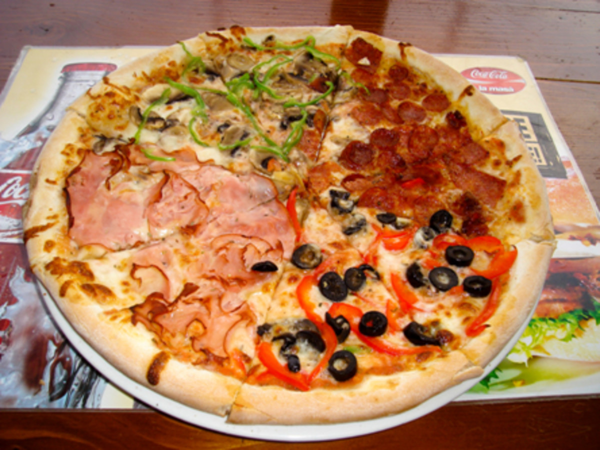 Pizza Quatro Stagioni. Most of pizza types have chese or mozarella, mushrooms and olives.