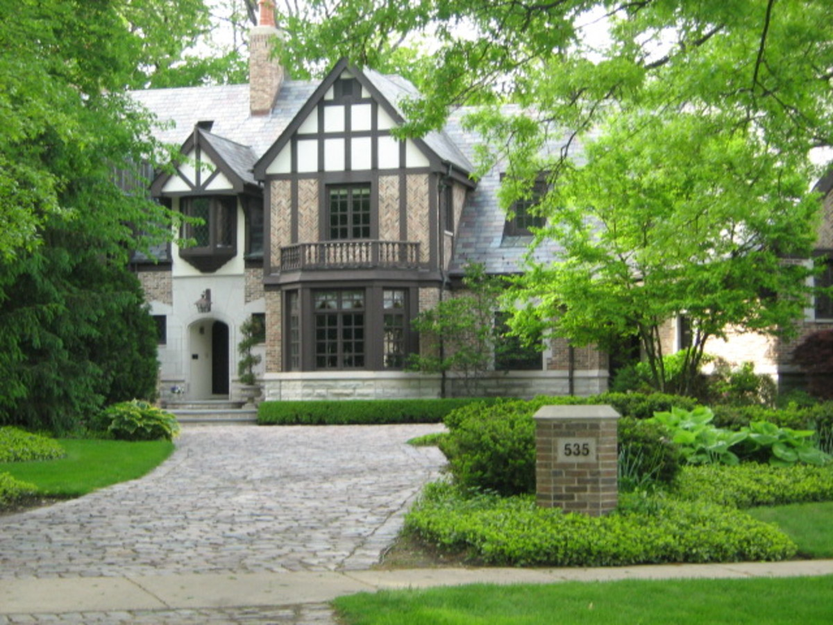 Large home with brick walkway leading to and around the home in Hinsdale
