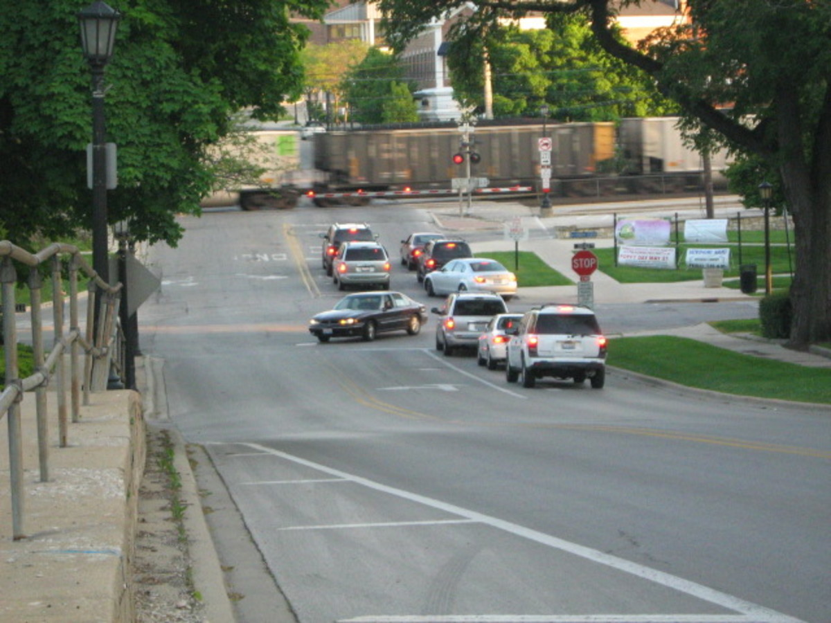 Traffic backing up as a train passes through downtown Hinsdale - a drawback from having available commuter traffic running through the center of the village