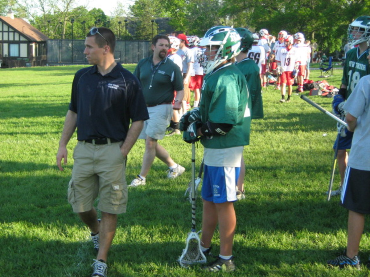 Lacrosse players along the sidelines at a game played at Katherine Legge Memorial Park