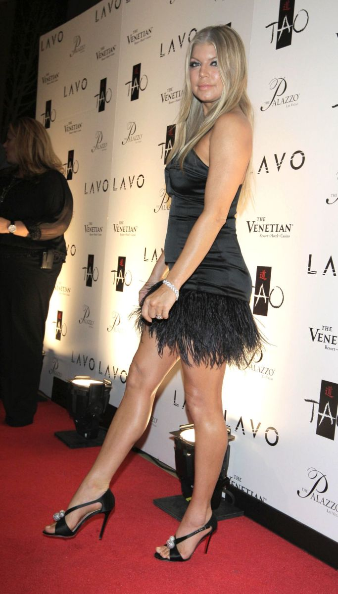 Fergie in a little black dress and high heels at a hotel opening