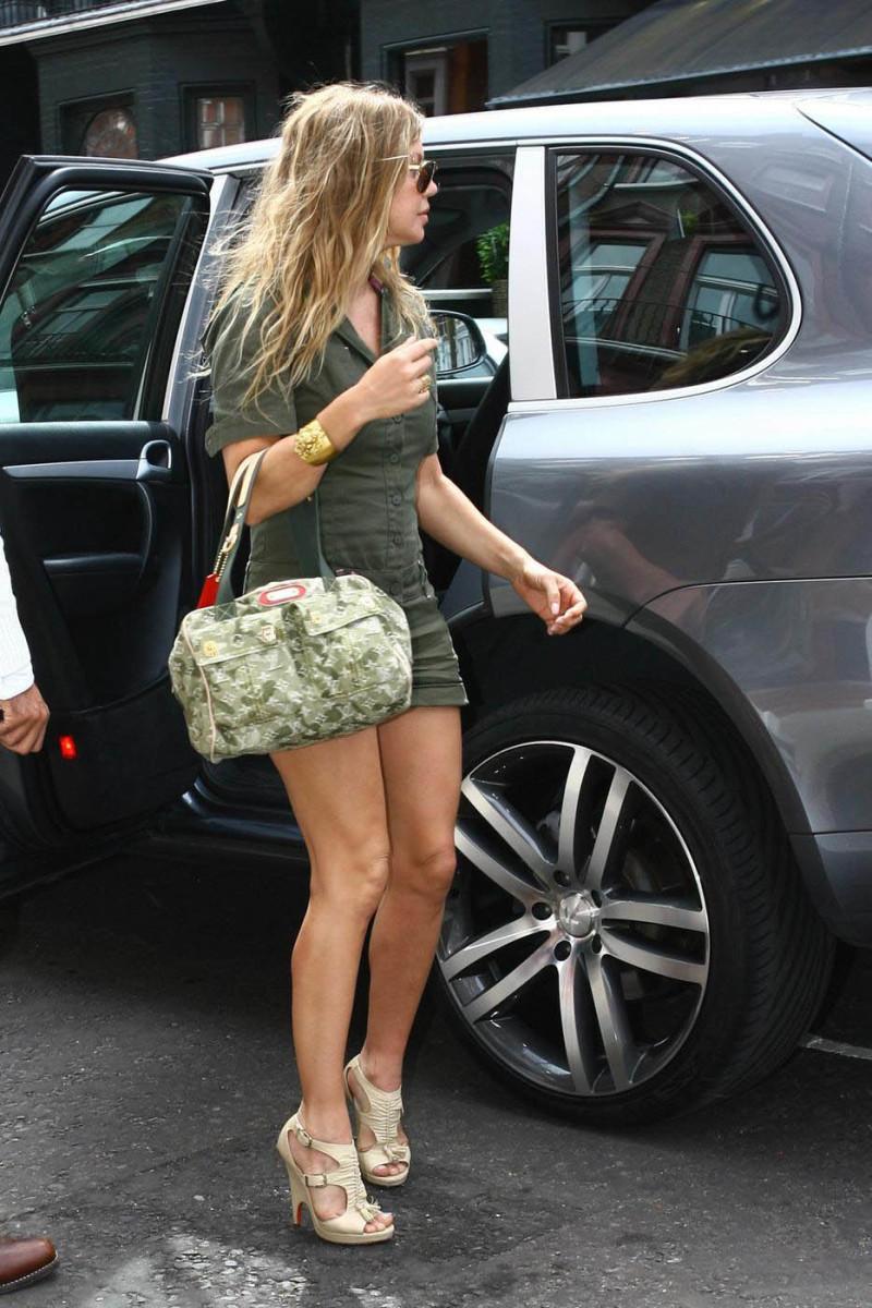 Fergie in high heels out running errands in a green short jumper