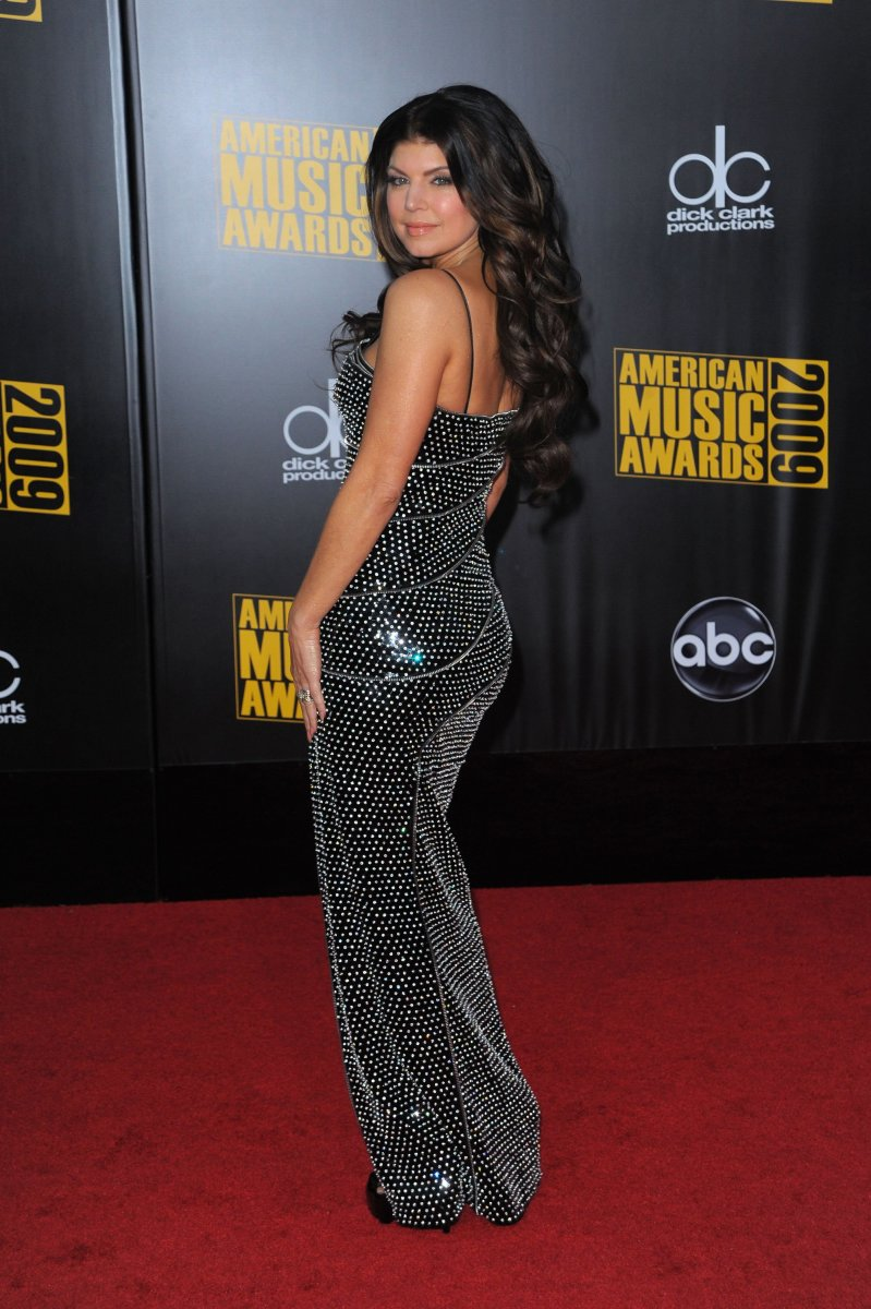 Fergie attending the 2009 AMA's in a full length dress and high heels