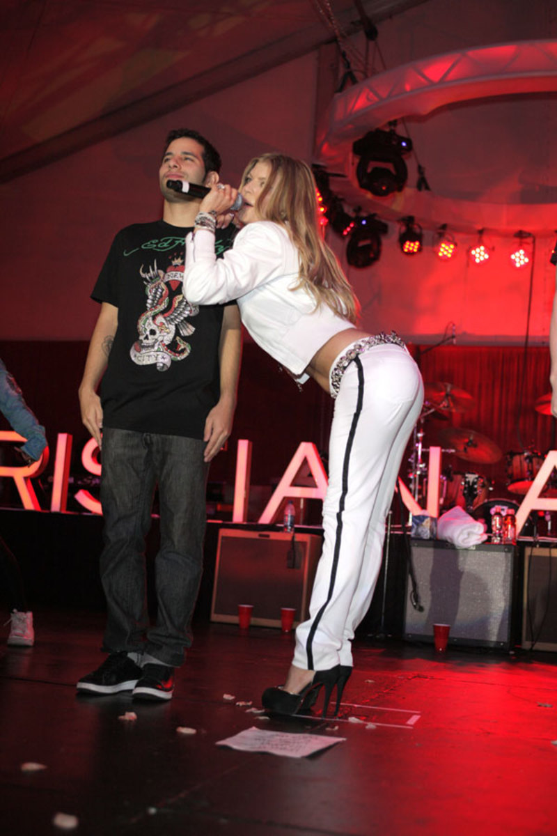 Fergie performs in high heels and an athletic outfit