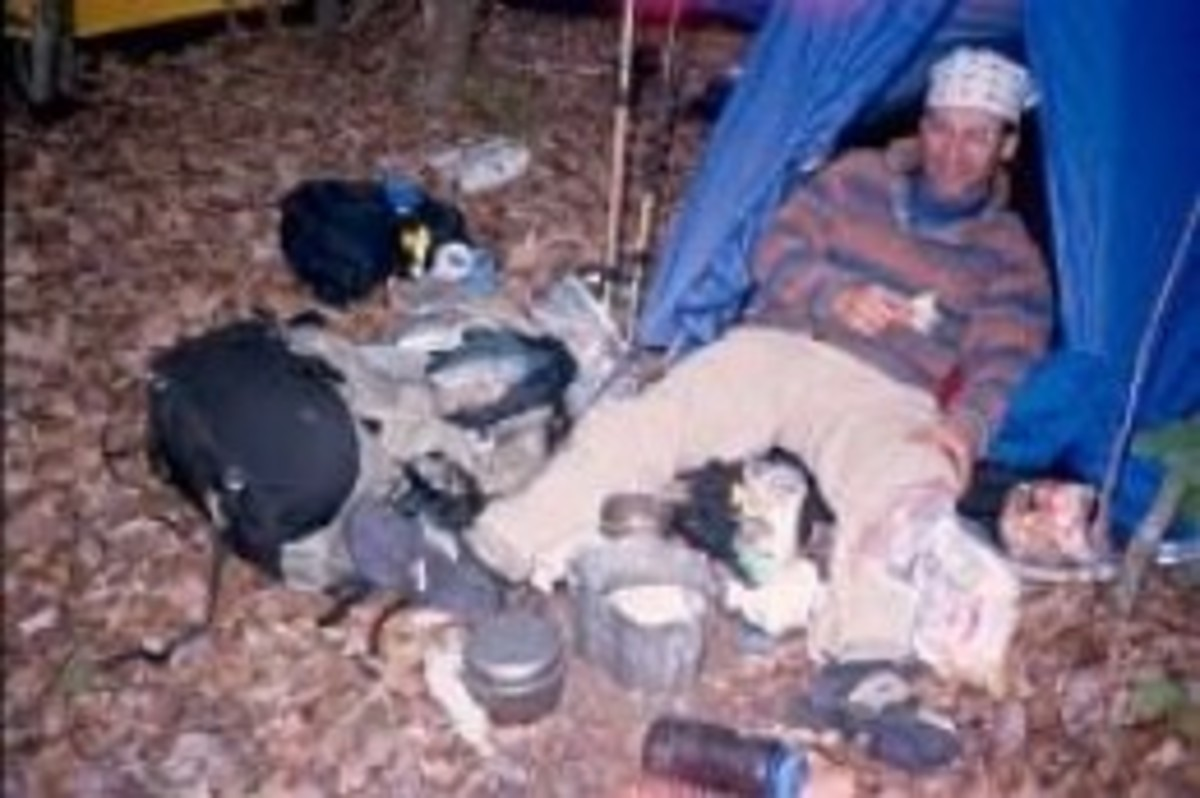 A thru-hiker called Joker is too tired and sore to do much about cooking dinner. Instead, he just lies there and stares at his gear and uncooked food.