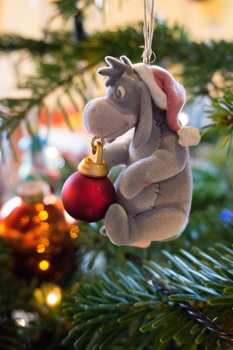 Eeyore Christmas Ornament - lovely cute ornament you can add this to a Winnie the Pooh themed tree, a Disney tree or if it's your child's favorite just add it to your regular family tree for them.
