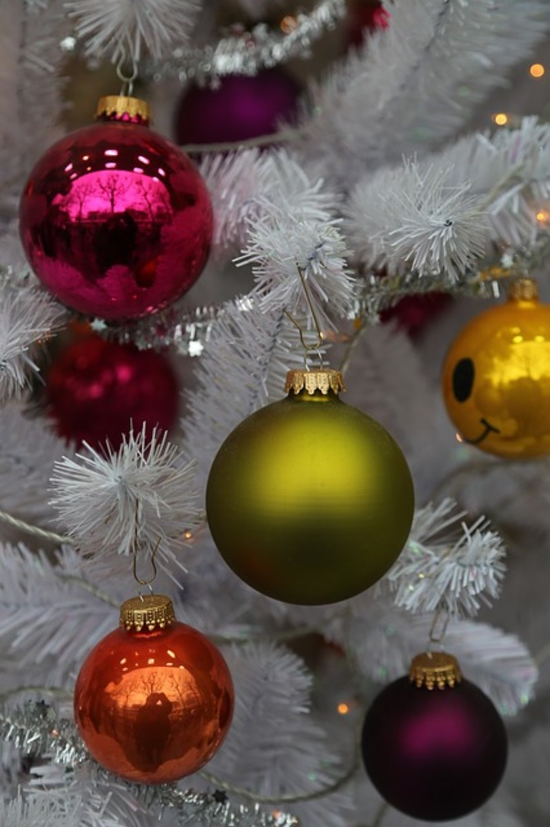 Colored Christmas Ornaments on a White Tree